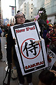 March 16, 2012, Tokyo, Japan - A fan of the new iPad holds a poster, in the center is written in Japanese samurai. .Fans lined up overnight outside the Apple store in Ginza, to buy the new iPad. Japan was one of the first countries where Apple fans could get their hands on the new iPad.