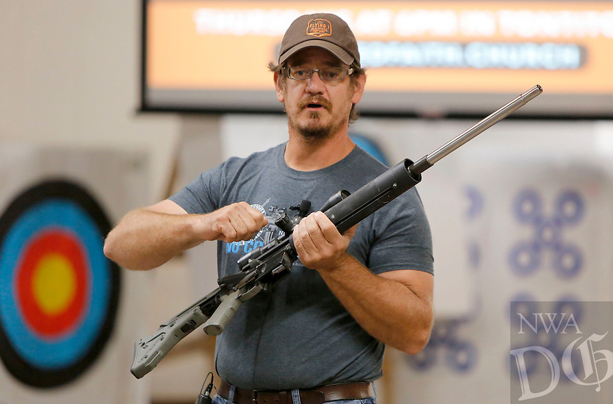 NWA Democrat-Gazette/DAVID GOTTSCHALK  Alfred Stevens displays a competitive target rifle Thursday, October 22, 2015 as he discusses long range shooting at Rugged Faith in Tontitown. Stevens was the guest speaker at the church that is geared towards sportsmen.