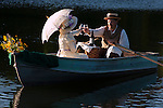 Victorian Couple in a rowboat at sunset toasting with wine glasses