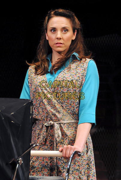 """MELANIE CHISHOLM (Mel C) .as Mrs Johnston .""""Blood Brothers"""" photocall, Phoenix Theatre, London, England, UK, .October 21st 2009..scene acting on stage set costume musical half length floral wrap dress blue turquoise shirt sleeveless pushing pram  .CAP/CAS.©Bob Cass/Capital Pictures."""
