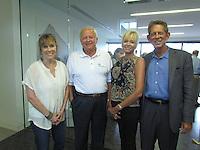 Northwest Arkansas Free Health Center volunteer Dr. Margaret Rutherford, Warren McDonald, Sheri Rothwell and Woody Bassett enjoy the evening together.