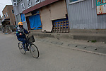 A Peace Boat volunteer on a bicycle  takes part in the clean-up operations in Ishinomaki, Miyagi Friday May 6th 2011. Around 350 volunteers took part in the relief effort over the Golden Week holiday, including 41 foreigners, clearing mud and removing debris from this coastal town which more almost levelled in the March 11th earthquake and tsunami.
