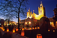 Christms Eve candles called faralitos decorate the walls and plaza surrounding the San Felipe de Neri church in the Old Town district of Albuqueque