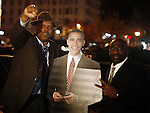 Black Men pose for their photo to be taken with a cutout of President elect Barack Obama in Harlem New York NY .Tuesday Nov 4 2008.  Millions of voters across the United States went to the polls in record numbers to choose between Presidential candidates Barack Obama and John McCain.. Photo by Eyal Warshavsky .