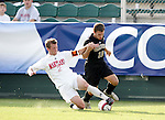Maryland's Michael Dello-Russo (2) tries to tackle the ball from Wake's Justin Moose (10) on Wednesday, November 9th, 2005 at SAS Stadium in Cary, North Carolina. The University of Maryland Terrapins defeated the Wake Forest University Demon Deacons 2-1 during their Atlantic Coast Conference Tournament Quarterfinal game.