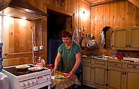 Women at home preparing food in wooden kitchen, Listvyanka near  Irkutsk, Siberia, Russia