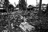 The disorderly growth of Agua Branca gold mining village transformed the former cemetery in a dump, Para State, Amazon, Brazil.