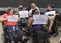 "Members of the Taxis For All Campaign and their supporters protest in front of Uber headquarters in West Chelsea in New York on Thursday, July 30, 2015. The protesters had a ""roll-in"" calling on the company to stop discriminating against the disabled by requiring handicapped accessible vehicles. Out of 20,777 Uber cars on the road not one of them is wheelchair accessible. (© Richard B. Levine)"