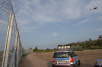 Police helicopter patrols the razor wire fence on the border between Serbia and Hungary near Roszke (about 174 km South of capital city Budapest), Hungary on September 15, 2015. ATTILA VOLGYI