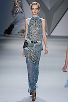 Daria Strokous walks runway in a Dutch blue silk chiffon crystal embroidered harness gown with stand collar and column print faille zip-front peplum over silk chiffon boy short, from the Vera Wang Fall 2012 Vis-a-gris collection, during Mercedes-Benz Fashion Week Fall 2012 in New York.