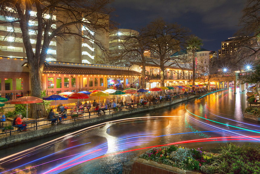 As boats coast along the Riverwalk in San Antonio, Texas, they leave light trails during this long exposure. On Saturday evenings, this 2.5 miles of walkways provide ample strolling for those who want to enjoy the pleasant experience.<br />