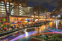 As boats coast along the Riverwalk in San Antonio, Texas, they leave light trails during this long exposure. On Saturday evenings, this 2.5 miles of walkways provide ample strolling for those who want to enjoy the pleasant experience.<br /> <br /> See more at www.ImagesfromTexas.com