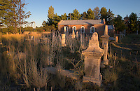 The sun sets over Welsh language grave stones at the Moriah chapel in Trelew in Patagonian Argentina. Welsh immigrants tames the desolate land along the Rio Chubut in the 1860s. Their ancestors now embrace their Welsh roots in more than a dozen teahouses. (Kevin Moloney for the New York Times)