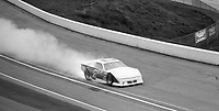 The #7 ASA late model car of Hut Stricklin blows an engine and erupts in flames during a preliminary race before the Atlanta Journal 500 at Atlanta International Raceway on November 11, 1984. (Photo by Brian Cleary/www.bcpix.com)