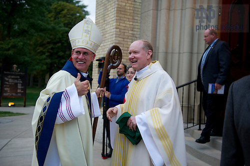September 16, 2011; Bishop Kevin Rhoades and Rev. Timothy R. Scully, C.S.C., right, outside the Basilica of Sacred Heart after mass. Photo by Barbara Johnston/University of Notre Dame
