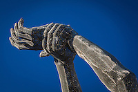 "The raised arms and hands of the ""Truth is Beauty"" sculpture on the San Leandro Tech Campus."