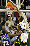 Seattle Supersonics' Rashard Lewis,r, dunks a basket over Phoenix Suns' Amare Stoudemire, l, in the second quarter at Key Arena in Seattle, Washington  on Sunday, 06 March 2005.  Jim Bryant Photo. &copy;2010. All Rights Reserved.