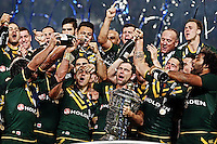 Picture by Vaughn Ridley/SWpix.com - 30/11/2013 - Rugby League - 2013 Rugby League World Cup Final - New Zealand v Australia - Old Trafford, Manchester, England - Australia's Cameron Smith celebrates victory with teammates.