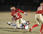 Lafayette High's Demarkous Dennis (5) vs. Louisville in MHSAA 4A playoff action at William L. Buford Field in Oxford, Miss. on Friday, November 18, 2011. Lafayette won 28-6 and will advance to play Amory.