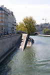 Riverfront apartment buildings in <br /> Paris, France