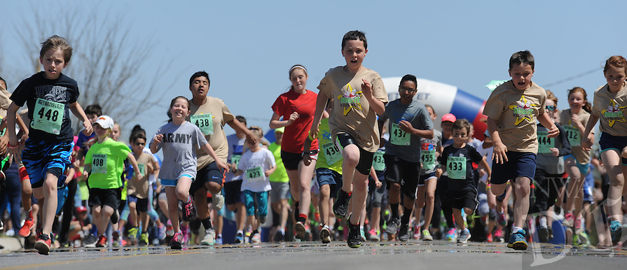 NWA Democrat-Gazette/ANDY SHUPE<br /> Saturday, April 9, 2016, at the start of the 40th annual Hogeye Marathon and Relays kids runs in Fayetteville. The event featured a 2.4-mile and 1-mile run ahead of today's marathon, half marathon, 5K and relays. Races begin at 7 a.m. today on the Fayetteville square. Spectators may also watch the race at points along the city's trail system such as Gordon Long Park and the Botanical Garden of the Ozarks. Full coverage of Sunday's races will be provided in Monday's sports section.