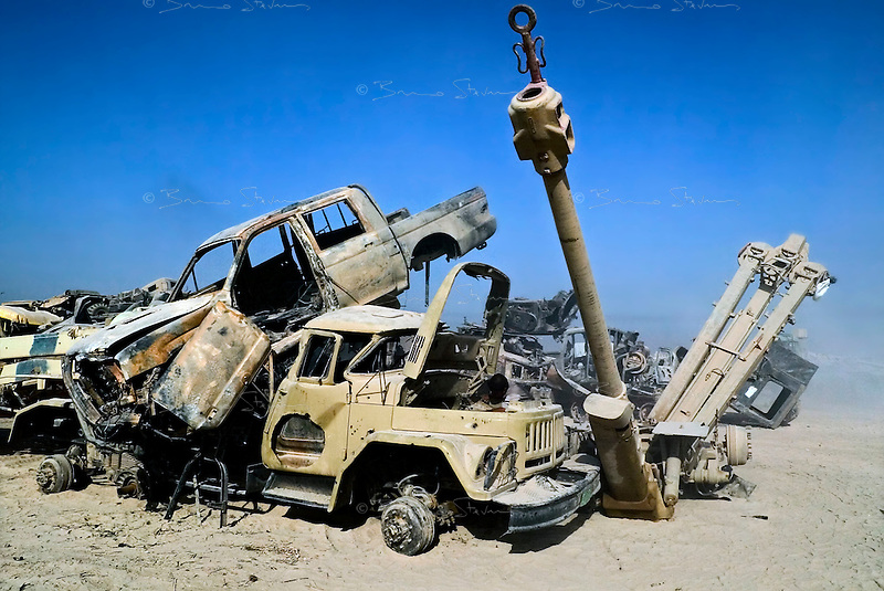Baghdad, Iraq, June 11, 2003.People recuperate metals, wheels, rubber, electric wiring and...explosives in a gigantic cemetery for disabled Iraqi military equipment just outside Baghdad..