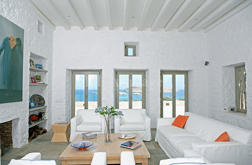 HOIMES..Stelios Konstantinos Hoimes' country house is located in the island of Paros. The architect John Soultantikas was responsible for all the tasks concerning the house's construction. Pembrooke & Ives of N.Y. assigned the interior designing to Andrew who combined the traditional style of the island with modern elements of architecture..