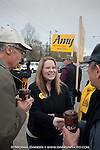 Amy Demboski greets supporters Lynn Joseph, left and John M. Park Tuesday afternoon.  Photo by Michael Dinneen for the Star.