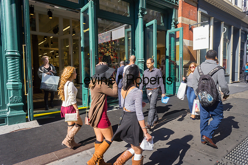 Shoppers outside of the & Other Stories in Soho in New York on Friday, October 17, 2014. The store is the sister brand of H&M selling women's fashions of better quality and slightly more expensive than H&M. This is the first store for the brand in the US which has been rolled out at  breakneck speed, opening seven stories worldwide in two months. (© Richard B. Levine)