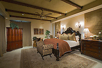 Elegant large guest bedroom with antique bed window coverings