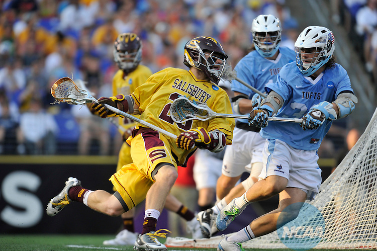 29 MAY 2011:  Tony Mendes (23) of Salisbury University moves the ball against Sam Diss (30) of Tufts University during the Division III Men's Lacrosse Championship held at M+T Bank Stadium in Baltimore, MD.  Salisbury defeated Tufts 19-7 for the national title. Larry French/NCAA Photos