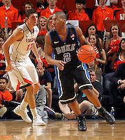 Feb. 16, 2011; Charlottesville, VA, USA; Duke Blue Devils guard Nolan Smith (2) handles the ball next to Virginia Cavaliers guard Joe Harris (12) during the second half of the game at the John Paul Jones Arena. The Duke Blue Devils won 56-41.  Credit Image: © Andrew Shurtleff