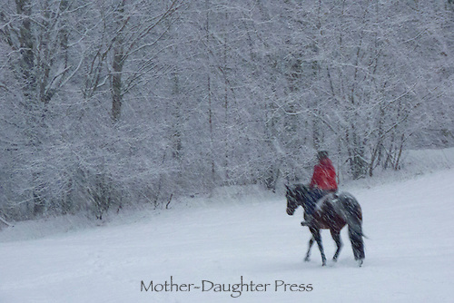 Girl rides horse in falling snow at dusk, Maine