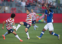 03 June 2012: US Men's National Soccer Team forward Landon Donovan #10 and US Men's National Soccer Team forward Herculez Gómez #9 battle for a ball with Canadian Men's National Soccer Team midfielder Julian de Guzman #6 during an international friendly  match between the United States Men's National Soccer Team and the Canadian Men's National Soccer Team at BMO Field in Toronto..The game ended in 0-0 draw..