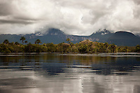 Tepuis, large flat topped mountains, stand all along the winding Canaima River, in Canaima National Park, Venezuela