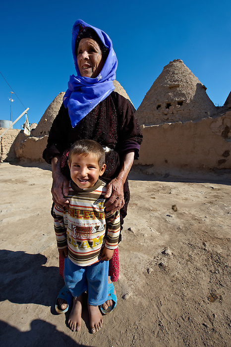 """Pictures of the beehive adobe buildings of Harran, south west Anatolia, Turkey.  Harran was a major ancient city in Upper Mesopotamia whose site is near the modern village of Altınbaşak, Turkey, 24 miles (44 kilometers) southeast of Şanlıurfa. The location is in a district of Şanlıurfa Province that is also named """"Harran"""". Harran is famous for its traditional 'beehive' adobe houses, constructed entirely without wood. The design of these makes them cool inside. 30"""