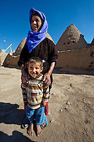 "Pictures of the beehive adobe buildings of Harran, south west Anatolia, Turkey.  Harran was a major ancient city in Upper Mesopotamia whose site is near the modern village of Altınbaşak, Turkey, 24 miles (44 kilometers) southeast of Şanlıurfa. The location is in a district of Şanlıurfa Province that is also named ""Harran"". Harran is famous for its traditional 'beehive' adobe houses, constructed entirely without wood. The design of these makes them cool inside. 30"