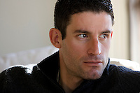 Discovery Channel Pro Cycling Team racer George Hincapie speaks to a writer in his home. Long successful in the European classics, in addition to being Lance Armstrong's right hand man on the team, Hincapie took his first Tour de France stage win in 2005.<br />