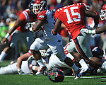Arkansas running back Dennis Johnson (33) is tackled by Ole Miss' Joel Kight (15) at Vaught-Hemingway Stadium in Oxford, Miss. on Saturday, October 22, 2011. .