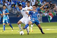 Gerson Rodas (12) Honduras holds off Richard Menjivar (16) El Salvador... Honduras defeated El Salvador 3-2 after extra time to go through to the final at LIVESTRONG Sporting Park, Kansas City, Kansas.