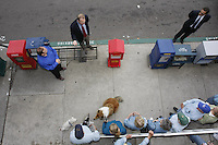 "San Diego Councilmember for District 2, Kevin Faulconer (top, left of center) speaks with members of the Point Loma Association about the recent removal of newspaper racks near the Point Loma Post Office in San Diego city, Friday November 16 2007.  The owners of the stands chose to remove the racks rather than comply with a new ordinance passed by San Diego City Council.  Some of the racks found around the city contain magazines and papers that many residents find offensive and lewd.  Others are in disrepair and are not properly maintained by their owners.  The ordinance will apply city-wide and Faulconer credited the Point Loma Association with ""getting the ball rolling"" and said that the rest of San Diego has them to thank for the new laws.  Bill Klees, (in blue shirt) Chair of the Point Loma Association stands to the left of Faulconer and Bob Vacchi, (dark sunglasses) a City Development Services Deputy Director stands to the right"