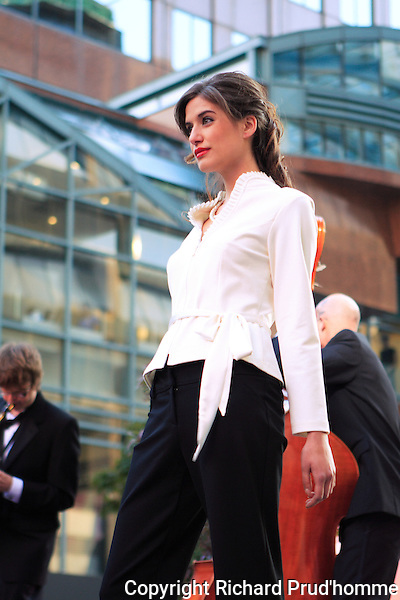 Frank Lyman fashion show held during the Montreal Fashion & Design festival in downtown Montreal. White blouse and black pants