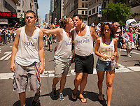 Gay family marches in the 43rd annual Lesbian, Gay, Bisexual and Transgender Pride Parade on Fifth Avenue in New York on Sunday, June 24, 2012. The parade took place on the one year anniversary of the legalization of gay marriage in New York.  (© Richard B. Levine)