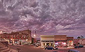 Uptown Jerome quietly coming to life at night. Ominous clouds hanging in the sky waiting to release the summer monsoons.