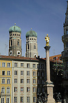 Statue of the Virgin Mary on a column in Marienplatz, against the background of the twin towers of Frauenkirche, Munich, Bavaria, Germany.