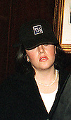 Washington, DC - January 23, 1999 -- Monica Lewinsky (wearing hat) walks through the lobby of the Mayflower Hotel in Washington, DC on 23 January, 1999.  She is scheduled to meet U.S. House Impeachment managers on 24 January, 1999..Credit: Ron Sachs / CNP