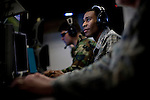 Signals intelligence analyst Staff Sergeant Roger Kennely, right, works on the operations floor at Beale Air Force Base in Linda, Calif., April 7, 2010.