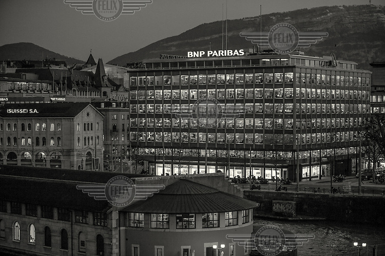 The offices of the private bank, BNP Paribas, illuminated at dusk.