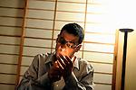 """Jake Adelstein, a former reporter at Japan's largest daily newspaper, Yomiuri Shimbun, lights a cigarette during an interview at an undisclosed location in Japan on Aug. 29, 2008. In 2005, American Adelstein -- who is the author of the recently released """"Tokyo Vice"""" -- uncovered a scandal involving senior members of Japan's mafia, the yakuza, visiting a medical center in Los Angeles to undergo liver transplants, despite being bared from entry due to having criminal records or suspected affiliation with Japanese organized crime groups. Within days, however, Adelstein was visited by mob members and told to either """"erase the story or be erased."""" He erased the story and resigned from the Yomiuri, though a  leak of his story at one time pushed Adelstein and his family into hiding..Photographer: Robert Gilhooly"""