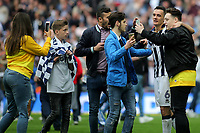 Millwall fans on the pitch at the end of the match have a selfie with Shaun Williams during Bradford City vs Millwall, Sky Bet EFL League 1 Play-Off Final at Wembley Stadium on 20th May 2017